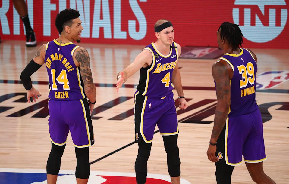 From left, Danny Green, Alex Caruso and Dwight Howard on the court.