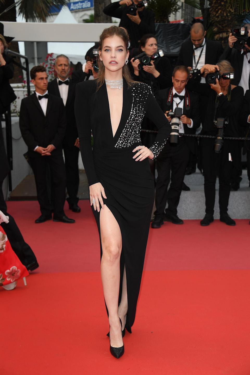 <p>The model looked stunning in a plunging black dress which featured crystal embellishment. [Photo: Getty] </p>