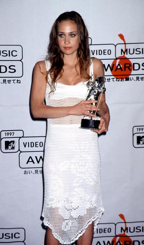 """<p>When waify songstress Fiona Apple was only 20 years old, she was presented with a Best New Artist award by none other than Elton John, beating out frontrunners like Hanson, the Wallflowers, and Jamiroquai, the latter of whom won a ton of VMAs for """"Virtual Insanity"""" that year.This was every young artist's dream. But not for Fiona. Instead she took her time at the podium to denounce the entire awards show. """"Everybody out there who is watching this world, this world is bulls***,"""" she ranted. It seemed ungrateful at the time, but looking back, maybe she had a point. (Source: Yahoo Music) </p>"""