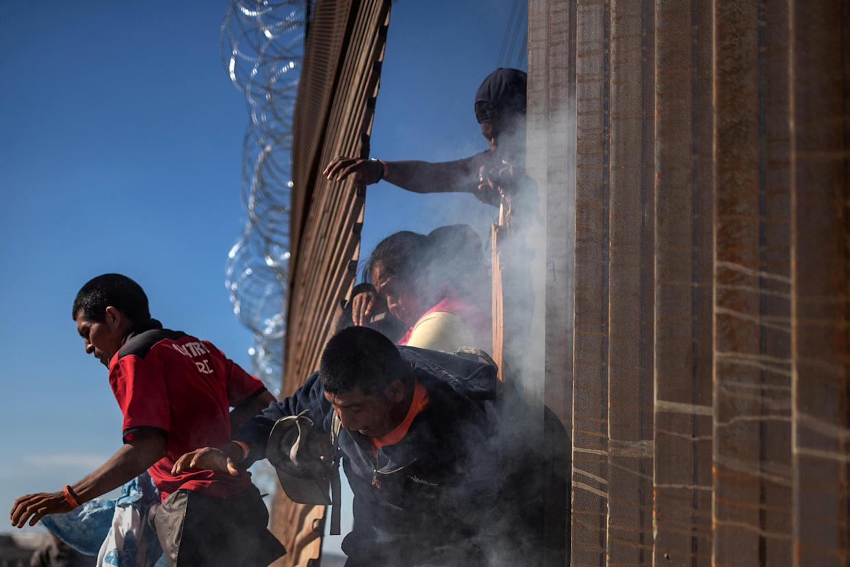 Migrants, part of a caravan of thousands from Central America trying to reach the U.S., return to Mexico after being hit by tear gas by U.S. Customs and Border Protection after attempting to illegally cross the border wall and enter the U.S. from Tijuana, Mexico, on Sunday. (Photo: Adrees Latif/Reuters)