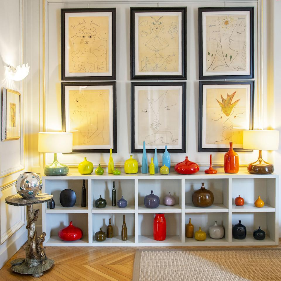 """<div class=""""caption""""> Rapin's collection of Ruelland French ceramics from the 1960s. On the wall hang six drawings by Jean Cocteau, also from the 1960s. The little tables in silvered wood are Austrian from the end of the 19th century and the vases are silver and hardstones by Kam Tin. </div>"""