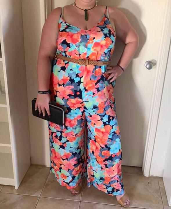 A photo of a woman wearing a floral Kmart jumpsuit.