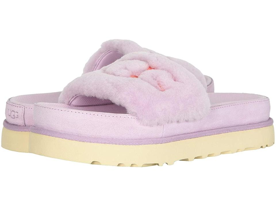"""<h2>Ugg Laton Fur Slide</h2><br>Not only do these lavender slides boast a foot-comforting fuzzy upper and road-ready soles, they're also cheekily emblazoned with the brand's iconic logo.<br><br><strong>Ugg</strong> Laton Fur Slide, $, available at <a href=""""https://go.skimresources.com/?id=30283X879131&url=https%3A%2F%2Fwww.zappos.com%2Fp%2Fugg-laton-fur-slide-california-aster%2Fproduct%2F9333558%2Fcolor%2F821190"""" rel=""""nofollow noopener"""" target=""""_blank"""" data-ylk=""""slk:Zappos"""" class=""""link rapid-noclick-resp"""">Zappos</a>"""