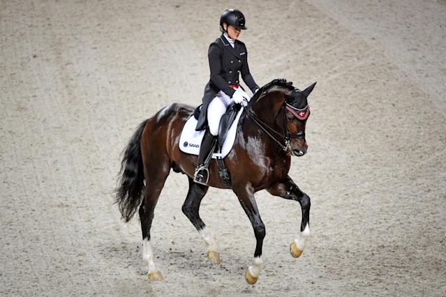 Equestrian - Sweden International Horse Show - FEI Grand Prix Freestyle to Music event - Friends Arena, Stockholm, Sweden - December 3, 2017 - Anna Zibrandtsen of Denmark rides her horse Arlando. TT News Agency/Jessica Gow via REUTERS ATTENTION EDITORS - THIS IMAGE WAS PROVIDED BY A THIRD PARTY. SWEDEN OUT. NO COMMERCIAL OR EDITORIAL SALES IN SWEDEN