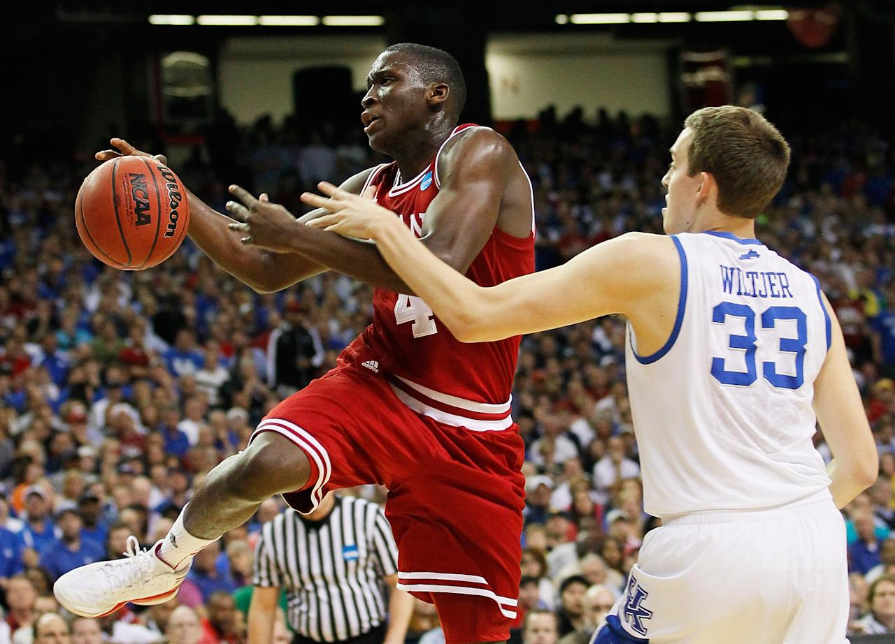 ATLANTA, GA - MARCH 23:  Kyle Wiltjer #33 of the Kentucky Wildcats fouls Victor Oladipo #4 of the Indiana Hoosiers in the first half during the 2012 NCAA Men's Basketball South Regional Semifinal game at the Georgia Dome on March 23, 2012 in Atlanta, Georgia.  (Photo by Kevin C. Cox/Getty Images)