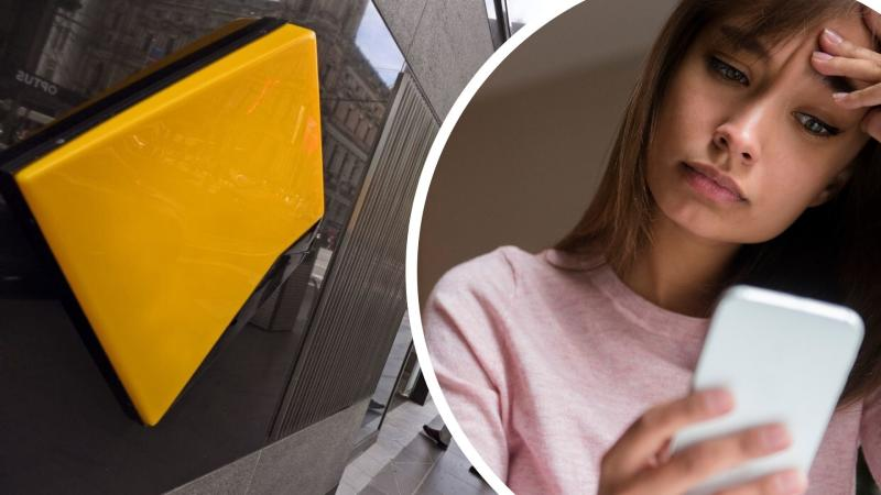 Pictured: CommBank store, woman looking at phone. Images: Getty