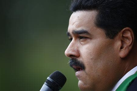 Venezuela's President Nicolas Maduro speaks to media after a meeting with his Palestinian counterpart President Mahmoud Abbas in Caracas