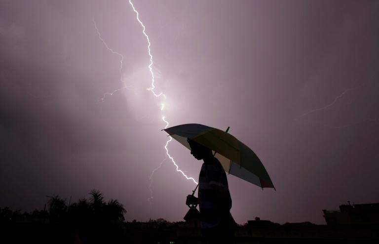 More than 2,300 people were killed by lightning in India in 2018 according to the National Crime Records Bureau, the most recent figures available (AFP Photo/Rakesh Bakshi)