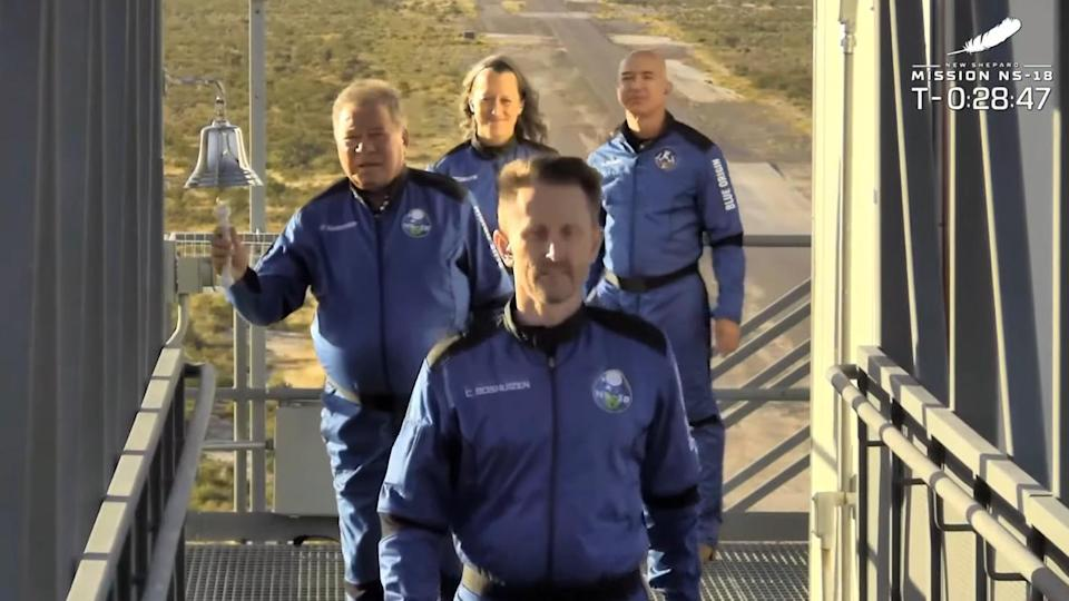 <p>The crew walks toward the shuttle ahead of the launch.</p>