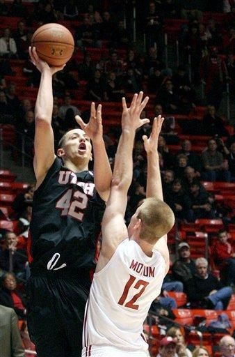 Utah's Jason Wasburn (42) takes the shot over Washington State's Brock Motum (12) during an NCAA college basketball game Thursday, Jan. 5, 2012, in Salt Lake City. (AP Photo/The Deseret News, Paul Fraughton) SALT LAKE TRIBUNE OUT; PROVO DAILY HERALD OUT; MAGS OUT