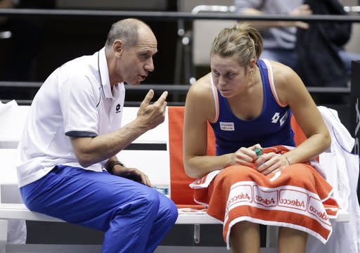 Italy coach Corrado Barazzutti, left, talks with Karin Knapp during a Fed Cup world group tennis match on Sunday, Feb. 9, 2014, in Cleveland. Knapp defeated United States' Alison Riske 6-3, 7-5. (AP Photo/Tony Dejak)