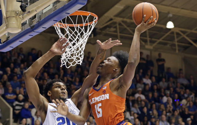 Duke's Marques Bolden (20) guards Clemson's John Newman III (15) during the first half of an NCAA college basketball game in Durham, N.C., Saturday, Jan. 5, 2019. (AP Photo/Gerry Broome)