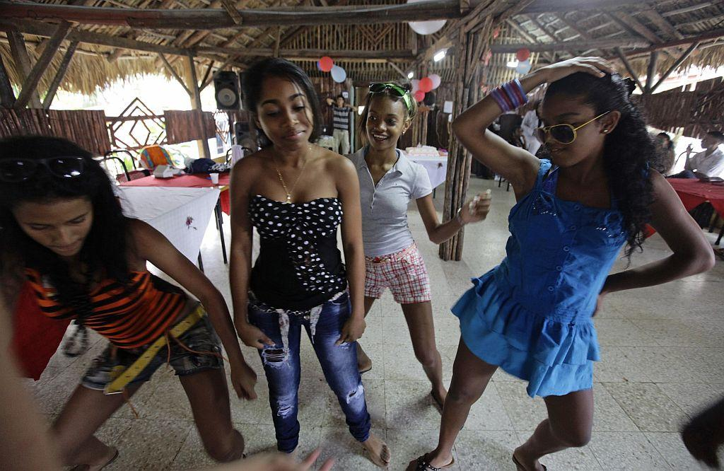 <p>Carmen Gonzalez (2nd L) dances with friends during her quinceanera.</p>