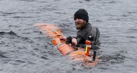 Subsea engineer John Haig launches Munin an intelligent marine robot to explore Loch Ness in Scotland
