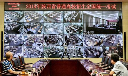 """Staff members monitor the venues as students sit for the annual national college entrance examination, or """"gaokao"""", in Xian, Shaanxi province, China June 7, 2018. Wang Jian/Xi'an Evening News via REUTERS"""
