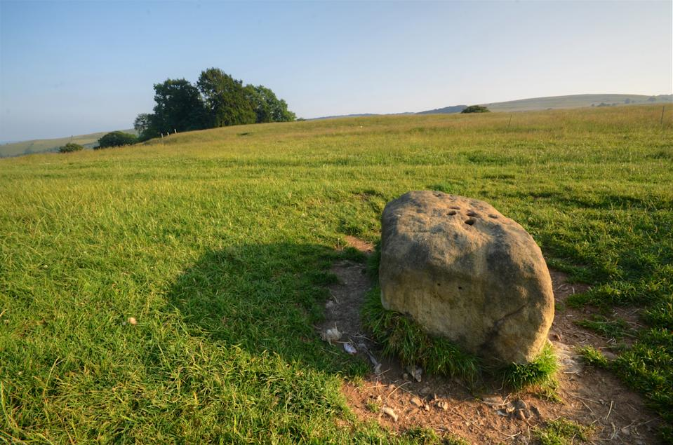 A boundary stone marking the edge of an infested Peak District village during the 17th century plague, where money and goods were exchanged.