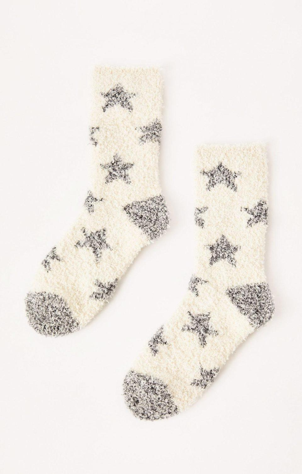"""<p>Trust us: Fuzzy socks are the ultimate crowd-pleaser. Bring this printed pair to White Elephant, and <i>everyone </i>will want to steal your gift. </p> <p><b>Buy it!</b> Star plush socks, $12; <a href=""""https://zsupplyclothing.com/collections/z-lounge/products/star-plush-socks"""" rel=""""nofollow noopener"""" target=""""_blank"""" data-ylk=""""slk:zsupply.com"""" class=""""link rapid-noclick-resp"""">zsupply.com</a></p>"""