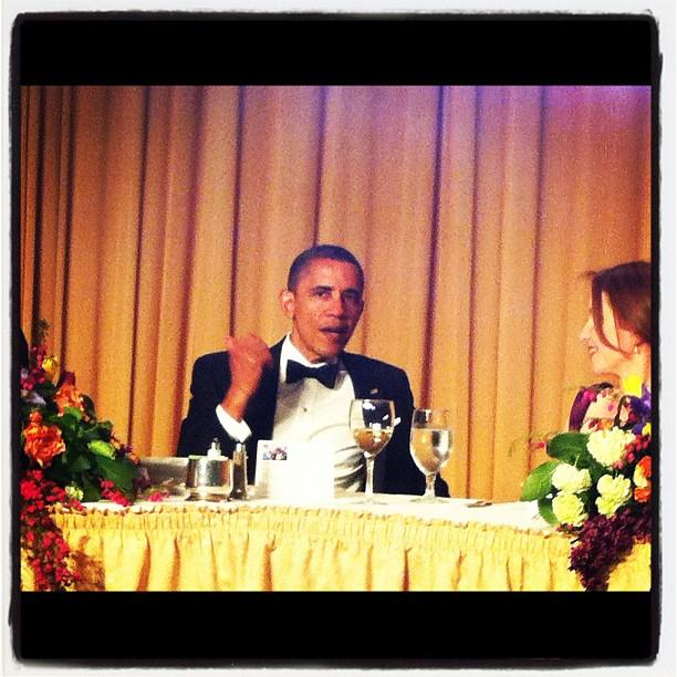 President Obama chatting it up on the #WHCD dais.