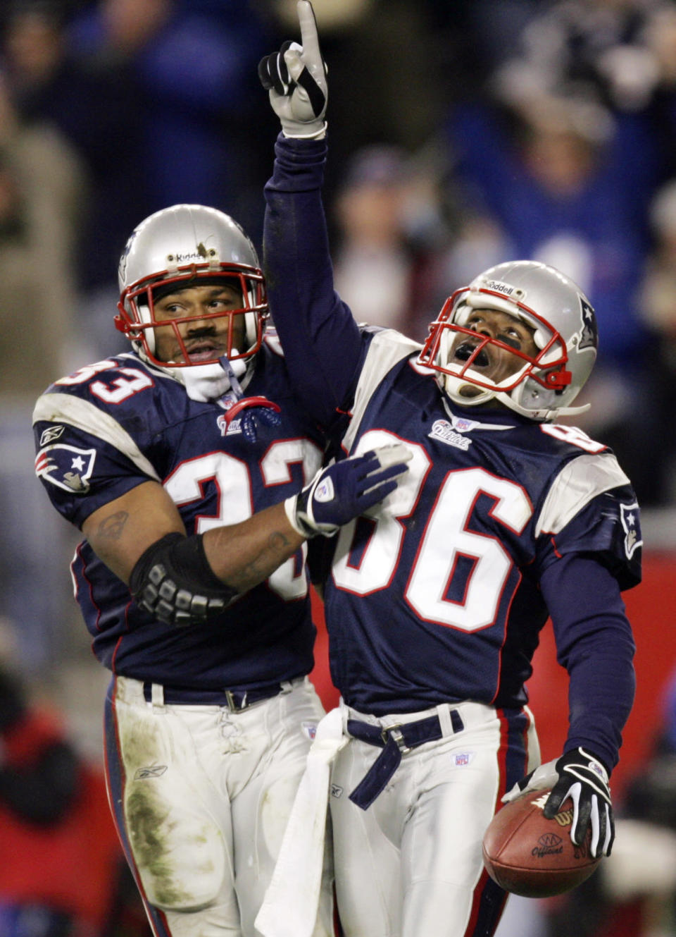 FILE - In this Nov. 14, 2004, file photo, New England Patriots' Kevin Faulk (33) celebrates with David Patten (86) after Patten's touchdown reception against the Buffalo Bills during the second quarter of an NFL football game at Gillette Stadium in Foxborough, Mass. Patten, who caught Tom Brady's first postseason touchdown to help the Patriots win their first Super Bowl, was killed in a motorcycle accident on Thursday night, Sept. 3, 2021, outside of Columbia, S.C., Richard County coroner Naida Rutherford said in a statement. He was 47. Patten played 12 seasons in the NFL after signing as an undrafted free agent with the New York Giants in 1997. (AP Photo/Winslow Townson, File)