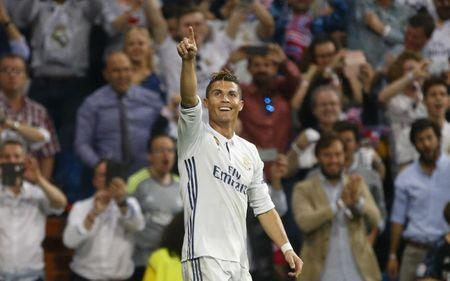 Real Madrid's Cristiano Ronaldo celebrates scoring their third goal