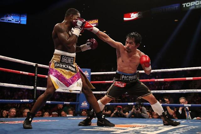 Pacquiao (R) easily won with an impressive display of superior hand speed and destructive power that landed him a unanimous decision victory over the much younger American at the MGM Grand Hotel in Las Vegas (AFP Photo/Christian Petersen)