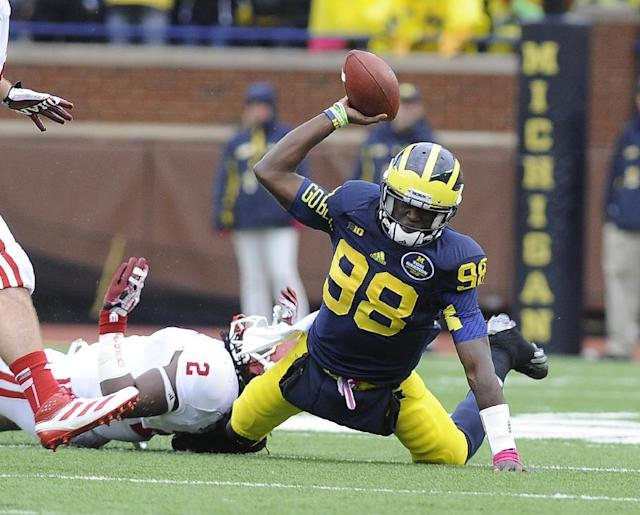 Michigan quarterback Devin Gardner throws the ball into the turf while being tackled by Indiana's T.J. Simmons in the second quarter of an NCAA football game at Michigan Stadium in Ann Arbor, Saturday, Oct. 19, 2013. (AP Photo/Lon Horwedel)