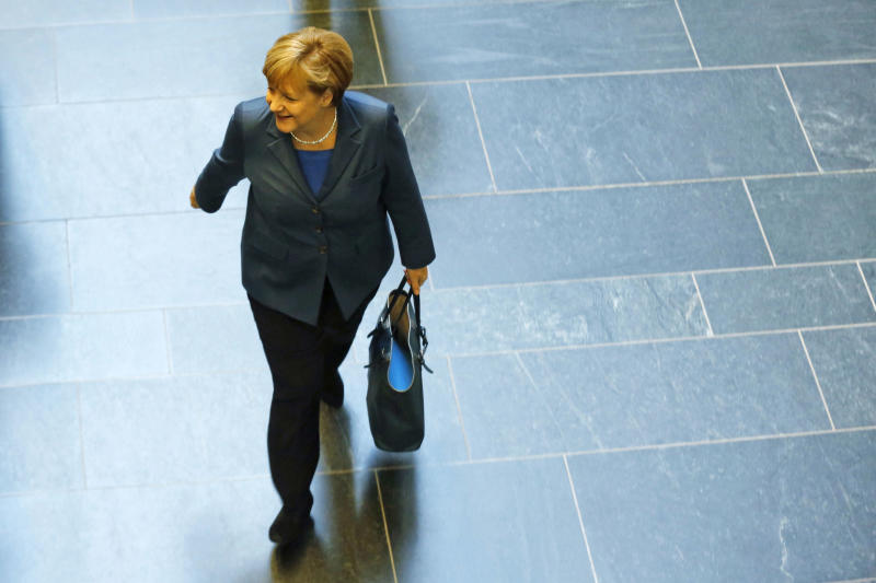 German Chancellor and chairwoman of the Christian Democrats (CDU) Angela Merkel arrives for a meeting with the Christian Democratic parties delegation prior to exploratory talks about an coalition with the Social Democratic Party (SPD) in Berlin Monday, Oct. 14, 2013. Following the national elections on Sept. 22, 2013 Angela Merkel still negotiates about an coalition partner for her third term. (AP Photo/Markus Schreiber)