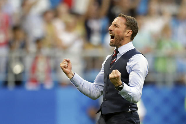 England head coach Gareth Southgate celebrates victory of his team over Sweden during the quarterfinal match between Sweden and England at the 2018 soccer World Cup in the Samara Arena, in Samara, Russia, Saturday, July 7, 2018. (AP Photo/Matthias Schrader )