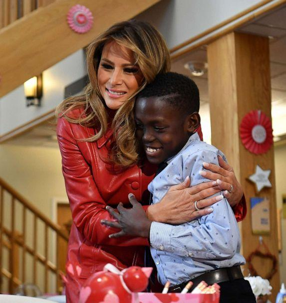 PHOTO: US First Lady Melania Trump gives a boy a hug during a Valentine's Day visit to kids at the Children's Inn at the National Institutes of Health in Bethesda, Md., on Feb. 14, 2020. (Mandel Ngan/AFP via Getty Images)