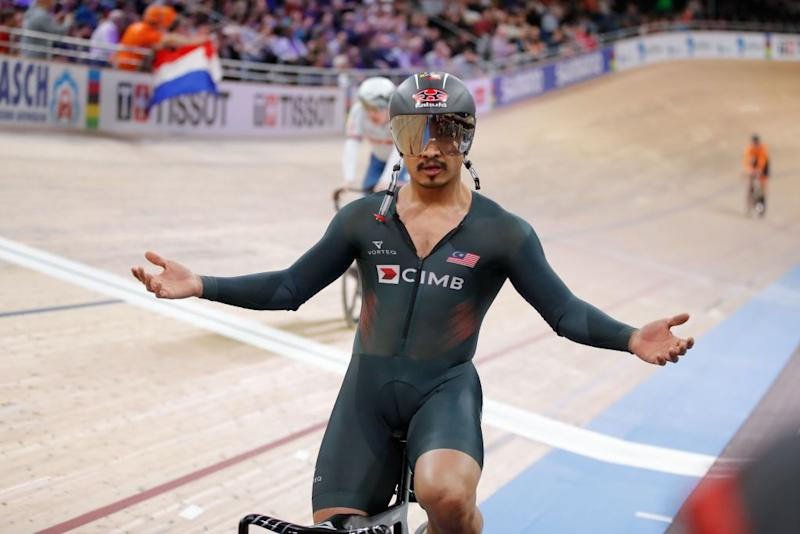 Malaysias Mohd Azizulhasni Awang celebrates Bronze in the mens 15 km Keirin final at the UCI track cycling World Championship at the velodrome in Berlin on February 27 2020 Photo by Odd ANDERSEN AFP Photo by ODD ANDERSENAFP via Getty Images