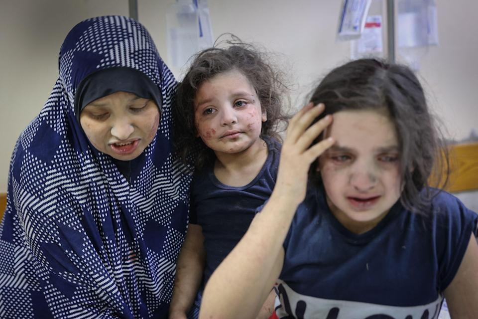 A Palestinian family arrives at Shifa hospital after intensive bombardments on GazaAFP via Getty Images