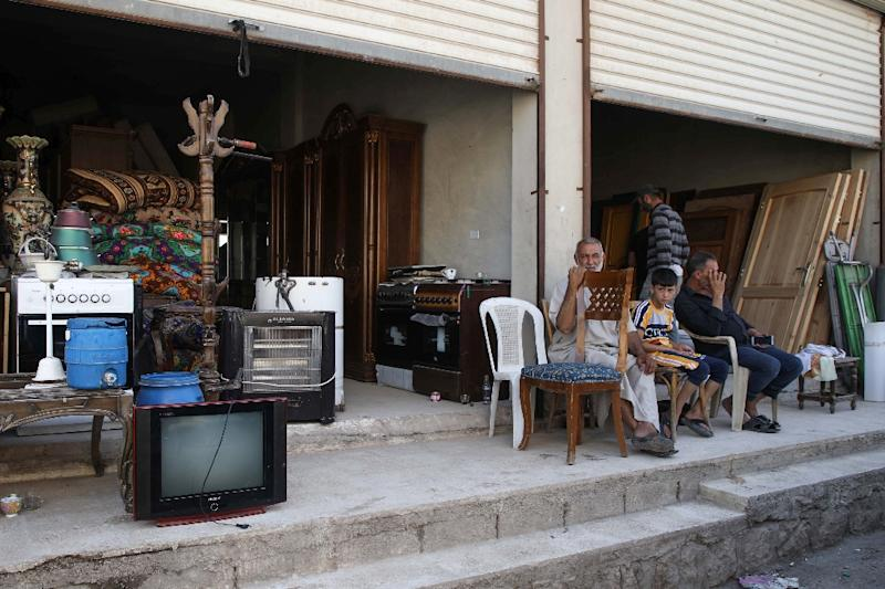 Owners of stores selling electrical appliances and furniture in Syria have often been flooded with stock sold to them by people fleeing their homes (AFP Photo/Aaref WATAD)
