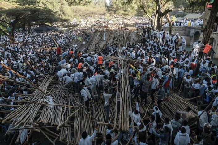 Hundreds had been sitting on a tiered wooden structure for hours when it collapsed (AFP Photo/EDUARDO SOTERAS)