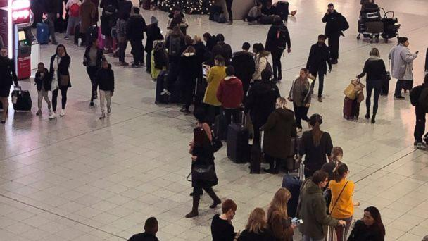 Queues of passengers cross a concourse in Gatwick Airport, as the airport remains closed with incoming flights delayed or diverted to other airports, after drones were spotted over the airfield last night and this morning Thursday Dec. 20, 2018. Lond (The Associated Press)