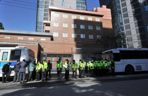 Policemen stand guard in front of the Japanese embassy in Seoul
