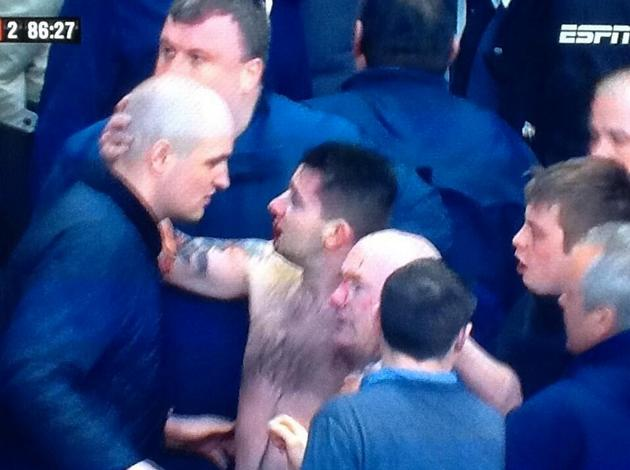 A topless and bloodied Millwall fan (@awaydays_)