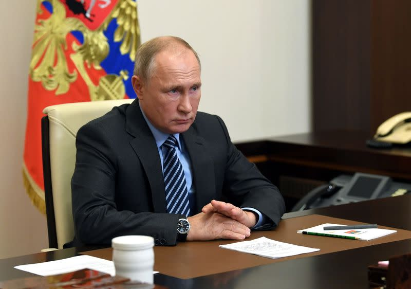 Russian President Vladimir Putin attends a meeting on a humanitarian mission in the region of Nagorno-Karabakh outside Moscow