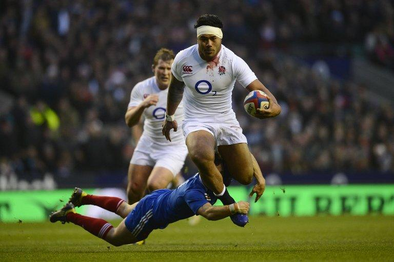 England centre Manu Tuilagi breaks through the French defence at Twickenham on February 23, 2013