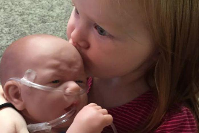 Nora Dolan with her 'baby Henry' while waiting on the real Henry to recover from a heart transplant. Photo: Facebook