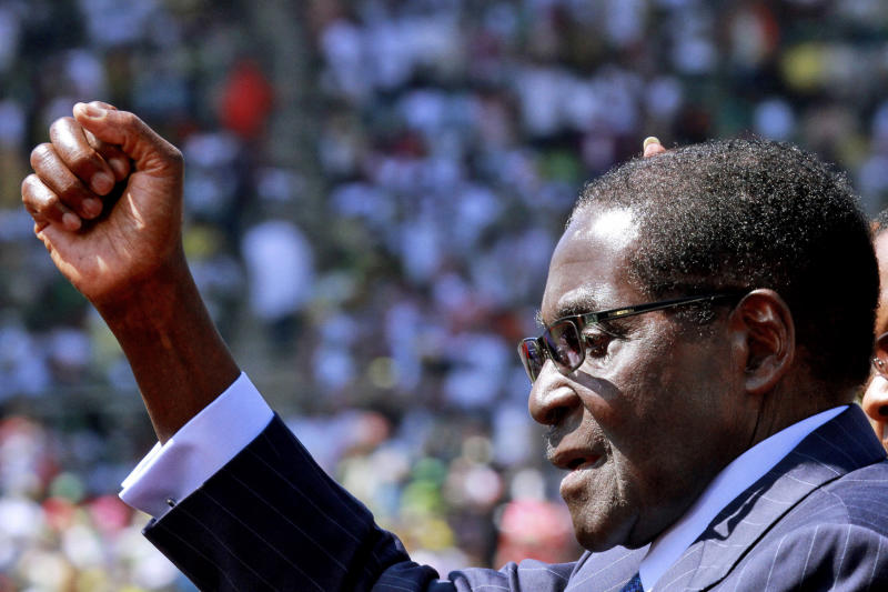 Zimbabwean President Robert Mugabe greets the crowd as he arrives for his inauguration in Harare, Thursday, Aug. 22, 2013. Mugabe, 89, was sworn in for a five-year term on Thursday after Zimbabwe's highest court on Tuesday threw out a legal challenge that alleged the July 31 elections won by President Robert Mugabe were marred by fraud. (AP Photo/Tsvangirayi Mukwazhi)