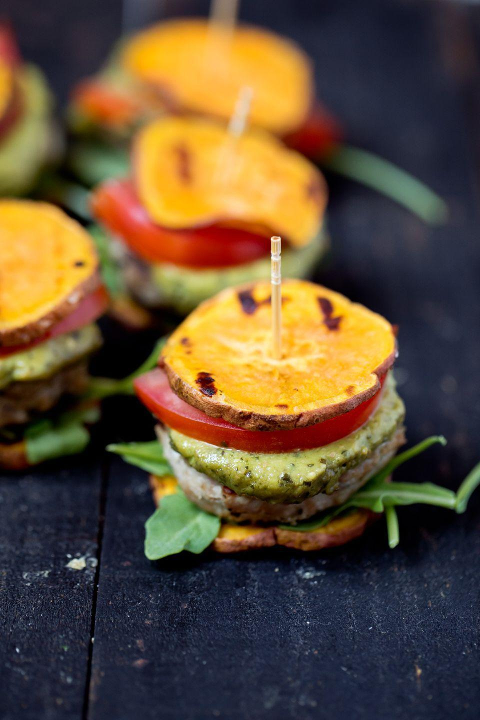 "<p>Even though you're eating healthy, it's not the Super Bowl without sliders. These turkey sliders use sweet potato slices instead of buns.</p><p><strong>Get the recipe at <a href=""https://www.ambitiouskitchen.com/pesto-turkey-burger-sliders-sweet-potato-buns/"" rel=""nofollow noopener"" target=""_blank"" data-ylk=""slk:Ambitious Kitchen"" class=""link rapid-noclick-resp"">Ambitious Kitchen</a>. </strong></p><p><strong><a class=""link rapid-noclick-resp"" href=""https://www.amazon.com/Lodge-Square-Pre-seasoned-Draining-Grilling/dp/B0000CF66W/?tag=syn-yahoo-20&ascsubtag=%5Bartid%7C10063.g.35089489%5Bsrc%7Cyahoo-us"" rel=""nofollow noopener"" target=""_blank"" data-ylk=""slk:SHOP GRILL PANS"">SHOP GRILL PANS</a><br></strong></p>"
