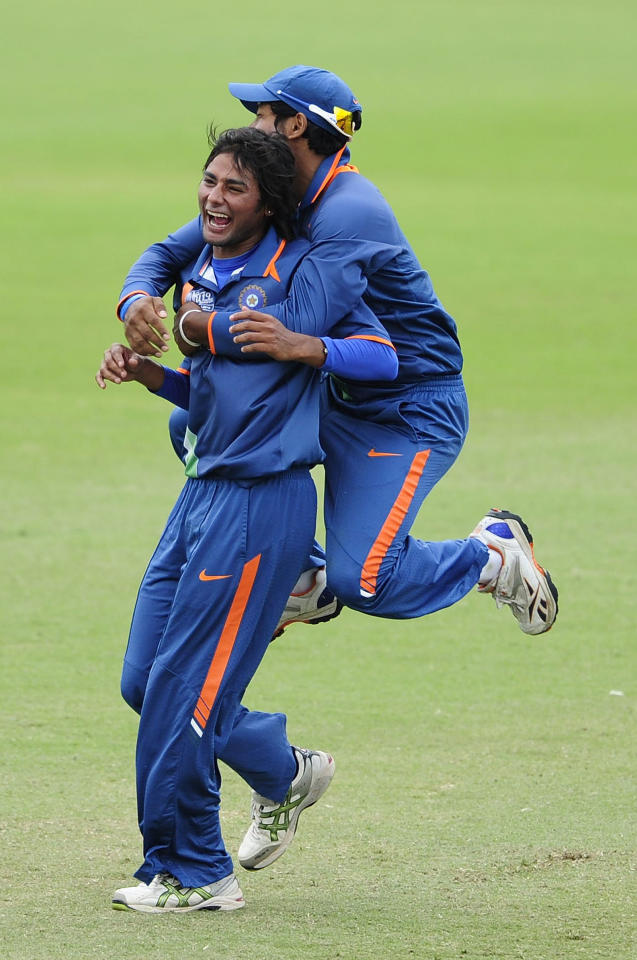 TOWNSVILLE, AUSTRALIA - AUGUST 20:  Aksh Deepnath of India celebrates with Kamal Passi of India after a Pakistan dismissal during the ICC U19 Cricket World Cup 2012 Quarter Final match between India and Pakistan at Tony Ireland Stadium on August 20, 2012 in Townsville, Australia.  (Photo by Ian Hitchcock-ICC/Getty Images)