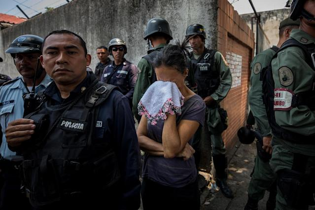 <p>A relative of prisoner cries, in the vicinity of the detention center of the State Police of Carabobo (center), in Valencia, Venezuela, March 28, 2018.(Photo: Miguel Gutiérrez/EPA-EFE/REX/Shutterstock) </p>