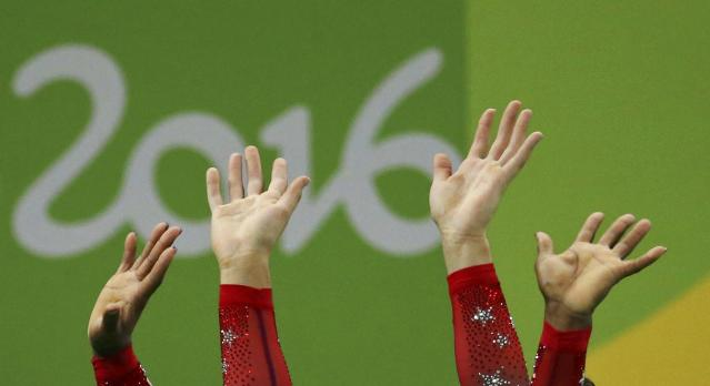 2016 Rio Olympics - Artistic Gymnastics - Final - Women's Floor Final - Rio Olympic Arena - Rio de Janeiro, Brazil - 16/08/2016. Close up of the hands of Simone Biles (USA) of USA and Alexandra Raisman (USA) of USA (Aly Raisman) as they celebrate winning the gold and the silver respectively. REUTERS/Ruben Sprich TPX IMAGES OF THE DAY. FOR EDITORIAL USE ONLY. NOT FOR SALE FOR MARKETING OR ADVERTISING CAMPAIGNS.