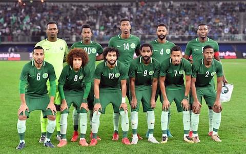 Saudi Arabia's 2018 World Cup squad is thoroughly analysed below. This is your guide to everything you need to know about the players who will be representing their country at the tournament, when their games are taking place, who is in charge of the team, the key men to watch and how they're likely to fare in Russia. To read our comprehensive guide simply register with the Telegraph and log in to your account. Saudi Arabia's World Cup preliminary squad - the 23 names 23-man final squad Goalkeepers: Mohammed Al Owais (Al Ahli), Yasser Al Mosailem (Al Ahli), Abdullah Al Mayouf (Al Hilal) Defenders: Mansoor Al Harbi (Al Ahli), Yasser Al Shahrani (Al Hilal) Mohammed Al Breik (Al Hilal), Motaz Hawsawi (Al Ahli), Osama Hawsawi (Al Hilal), Omar Hawsawi (Al Nassr), Ali Al Bulaihi (Al Hilal) Midfielders: Abdullah Al Khaibari (Al Shabab), Abdulmalek Al Khaibri (Al Hilal), Abdullah Otayf (Al Hilal), Taiseer Al Jassim (Al Ahli), Houssain Al Mogahwi (Al Ahli), Salman Al Faraj, Mohamed Kanno (both Al Hilal), Hattan Bahebri (Al Shabab), Salem Al Dawsari (Al Hilal), Yahya Al Shehri (Al Nassr), Fahad Al Muwallad (Al Ittihad) Forwards: Mohammad Al Sahlawi (Al Nassr), Muhannad Assiri (Al Ahli) Saudi Arabia's World Cup 2018 fixtures Russia 5 Saudi Arabia 0 Saudi Arabia vs Uruguay: Wednesday, June 20 at 4pm Egypt: Monday, June 25 at 3pm Saudi Arabia's World Cup record World Cup record: Saudi Arabia The kits See where Saudi Arabia's shirts ends up in our ranking of all 64 World Cup shirts below: World Cup kits ranked What odds are Saudi Arabia to win the World Cup? 1000/1 Who's the coach? Juan Antonio Pizzi. Former Spain striker who played for Bobby Robson at Barcelona, Pizzi resigned as Chile manager and last November became the third Saudi manager in three months. Saudi Arabia will play in their first World Cup since 2006 Credit: Getty Images Who's the star? They're not the lowest ranked team here for nothing - but Mohammad Al-Sahlawi scored eight in qualification against East Timor. Mohammad Al-Sahlawi trained with Manchester United earlier this year Credit: Getty Images Best thing about them Technically adept players with plenty of swazz, a lovely kit and in 'the Green Falcons', the best nickname. Worst thing about them Ponderous tempo and lack of physical stature make them as vulnerable as tethered goats for Uruguay's ruthless predators. Saudi Arabia lost to Italy in a pre-World Cup friendly in May Credit: Getty Images You may recognise… Yaya Al-Shehri is a nippy, Bercow-sized left winger who could nutmeg opponents with his body as well as the ball. Cameramen will be picking out… As is the intrusive way these days, ostentatiously pious goal celebrations - in the remote possibility they score, of course. Fans' favourite chant Oh oh, oh oh, oh ya Saudi! On-field prediction Haven't won a match in three World Cups since 1994 and that won't change here. Off-field prediction Paeans of praise for the Crown Prince and an epidemic of tinnitus from insufferable inflatable cheering sticks. Full 2018 World Cup squad lists and guides | Star to watch, odds, fans' chants and more WorldCup - newsletter promo - end of article