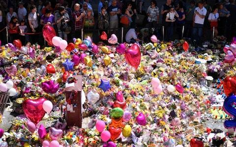Tributes to the Manchester terror attack, which killed 22 people - Credit: Ben Stansall/AFP
