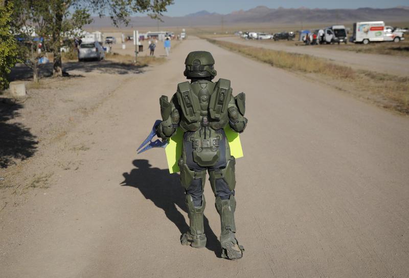 "A man in costume walks around an event at the Little A'Le'Inn inspired by the ""Storm Area 51"" internet hoax, Sept. 21, 2019, in Rachel, Nev. (Photo: John Locher/AP)"