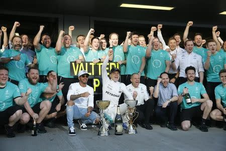 Formula One - F1 - Russian Grand Prix - Sochi, Russia - 30/04/17 - Members of Mercedes Formula One team, including drivers Valtteri Bottas of Finland and Lewis Hamilton of Britain, pose for a picture after the race. REUTERS/Maxim Shemetov