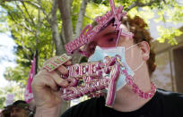 """Britney Spears supporter """"Jakeyonce"""" holds up a Free Britney necklace outside a court hearing concerning the pop singer's conservatorship at the Stanley Mosk Courthouse, Wednesday, June 23, 2021, in Los Angeles. (AP Photo/Chris Pizzello)"""
