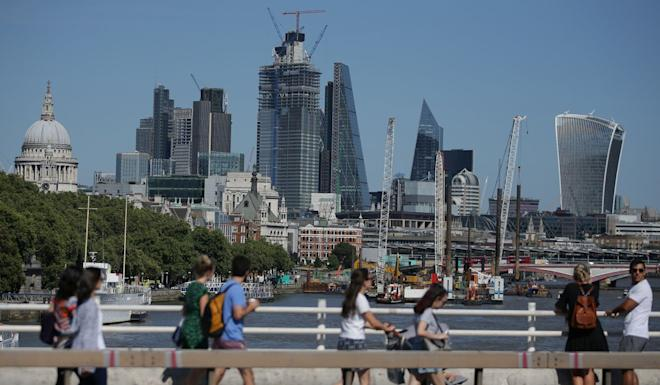 Skyscrapers and office buildings are pictured in the City of London as pedestrians use Waterloo Bridge to cross over the River Thames on August 1, 2018. Photo: AFP